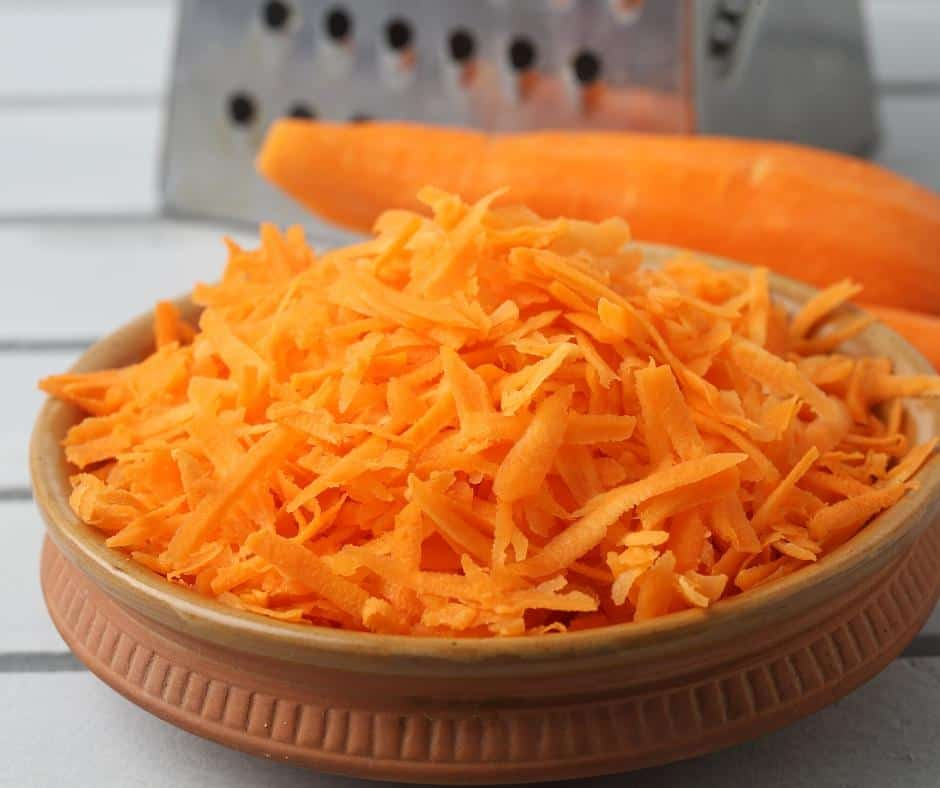 Grated carrots in a bowl.