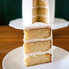 A slice of vanilla cake on a plate.