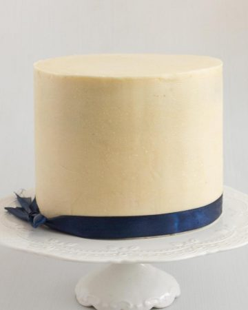 A cake decorated with white chocolate ganache.