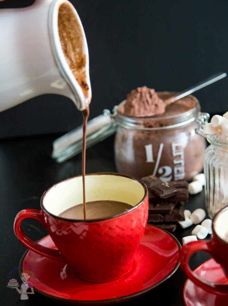 A pouring shot of this Hot chocolate recipe showing how thick, creamy and velvety the texture is.