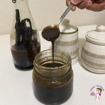A mason jar with vanilla bean paste