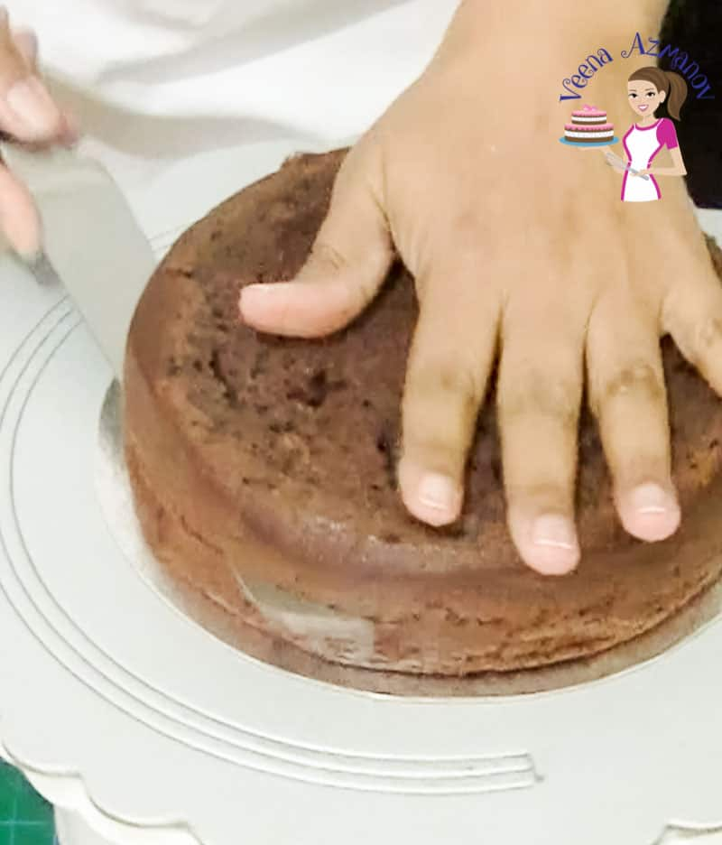 Progress Pictures for this video tutorial with progress pictures for how to ganache a cake perfectly every single time.