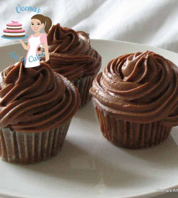 Cupcakes decorated with chocolate buttercream.