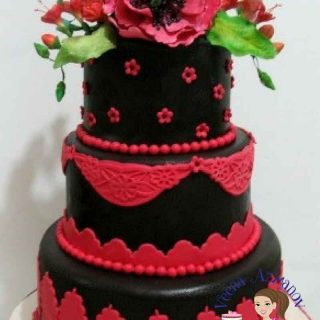 A black fondant decorated cake.