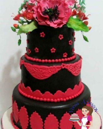 A black fondant decorated cake.