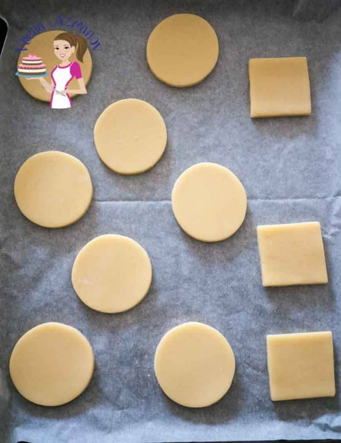 Unbaked sugar cookies on a baking tray.