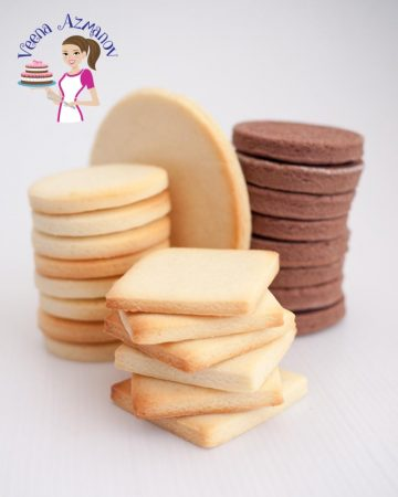 A stack of sugar cookies on a table.