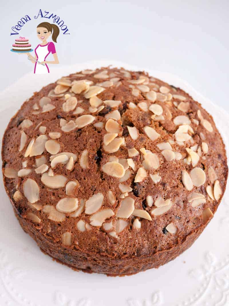 Top view of this fruitcake recipe, showing the top almond covered golden crust. Baked Fruit Cake Recipe with Orange Juice - no alcohold