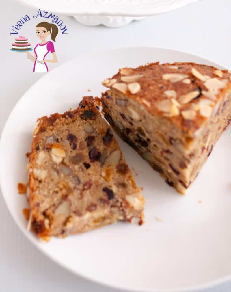A cut slice of this rich fruit cake made with orange juice and fruit and nuts, No Alcohol Rich Fruit Cake Recipe