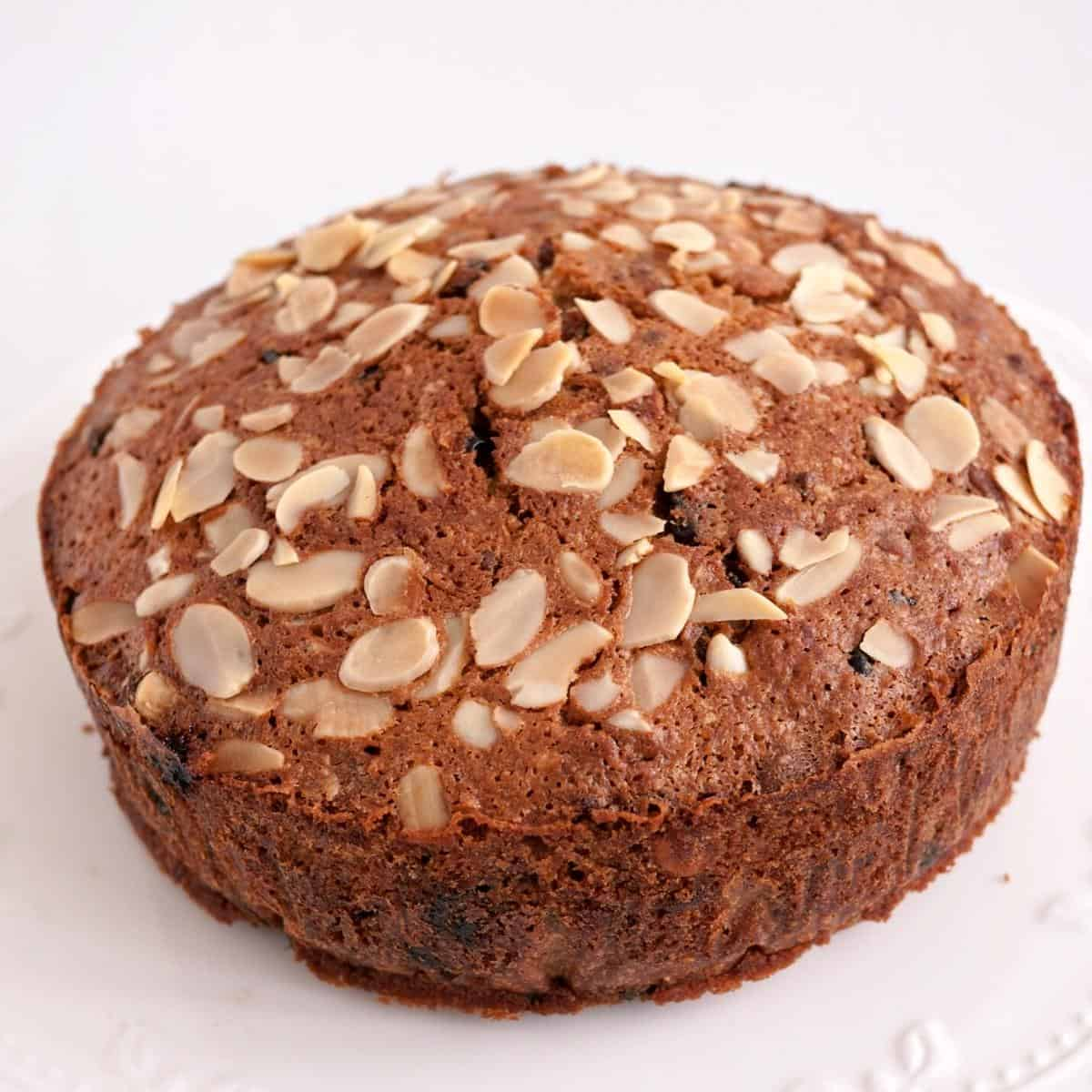 A fruit cake topped with almonds.