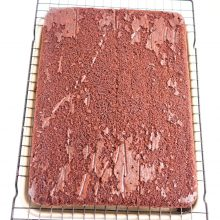 Sheet cake on a cooling rack.