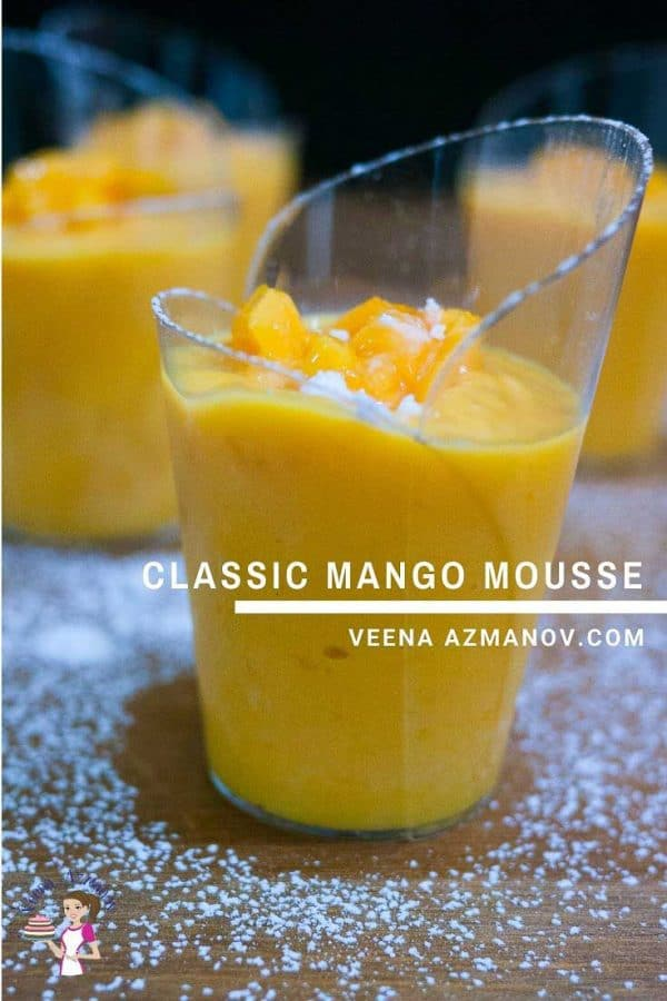 A close up of a glass of mango mousse.