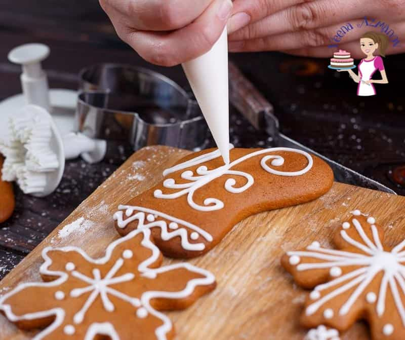 Decorating gingerbread cookies with icing.