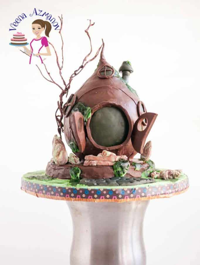 A cake decorated to look like a hobbit home.