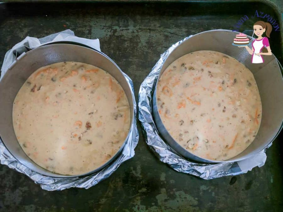 Two baking pans with carrot cake batter.