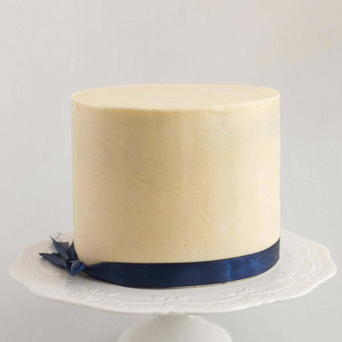 A frosted ganache cake with white chocolate ganache.