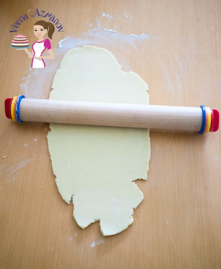 Rolling pin and cookie dough.