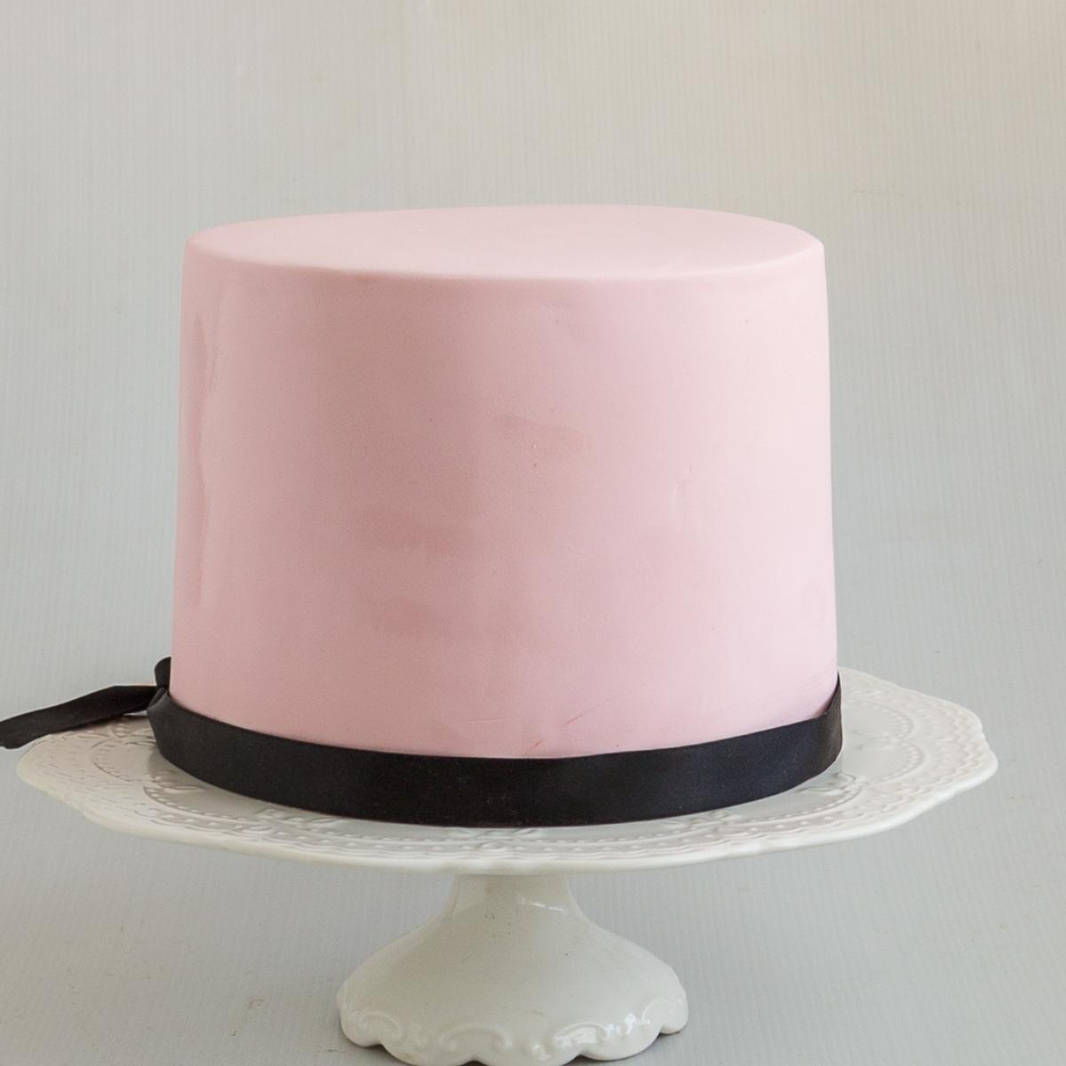 A cake decorated with pink fondant.