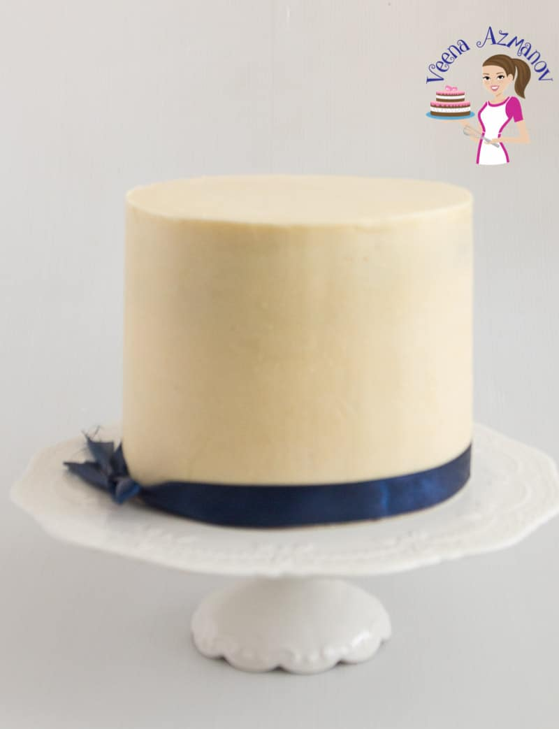 An image optimized for social media sharing for this cake decorators white chocolate ganache to be used under fondant cakes.