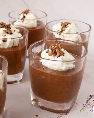 Chocolate mousse cups with whipped cream