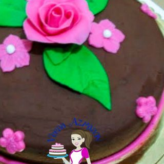 A close up of a decorated chocolate cake.
