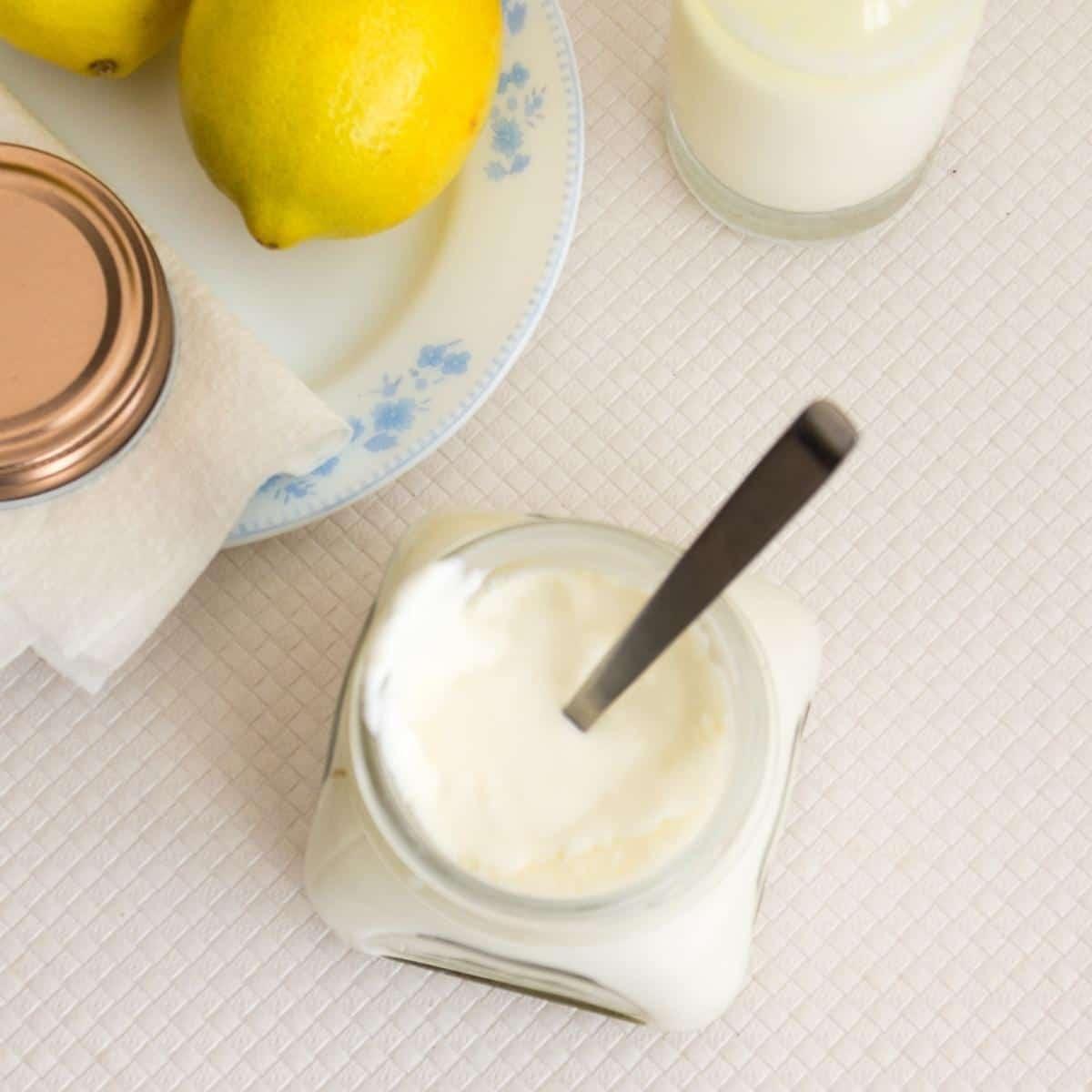 mason jar with sour cream on a table