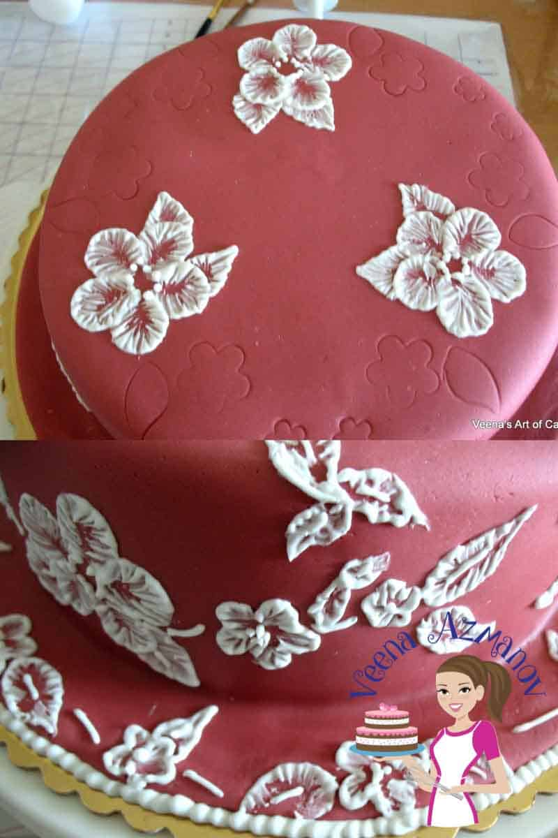 Progress photos of decorating a cake with a brush embroidery pattern.