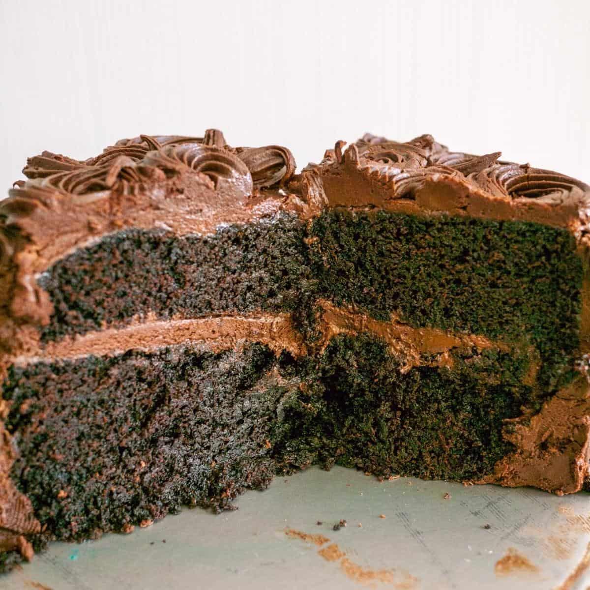 A cut chiffon cake on a cake stand.