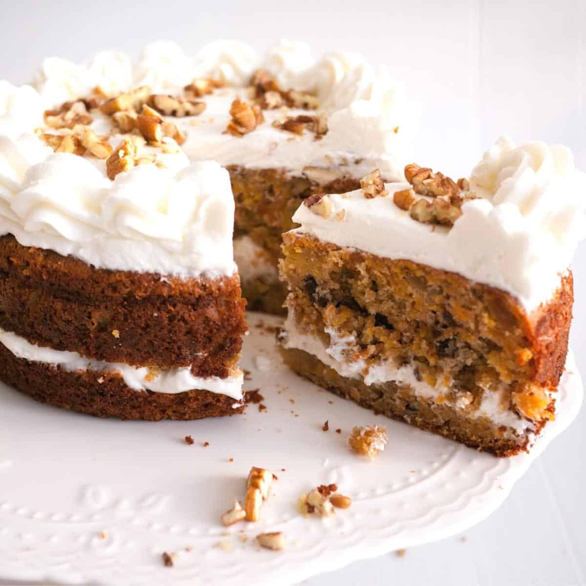 A carrot cake decorated with cream cheese