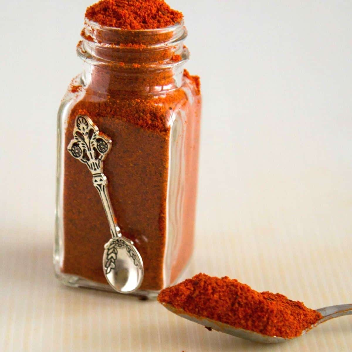 Shawarma spice in a jar and spoon.