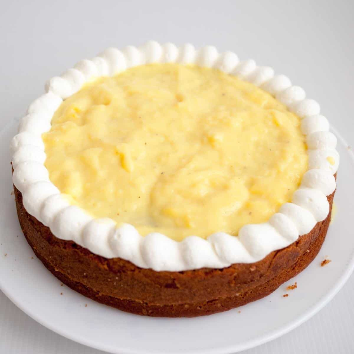A vanilla layer cake filled with pastry cream filling.