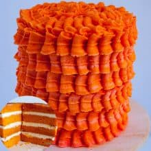 A frosted orange cake with Swiss meringue buttercream.