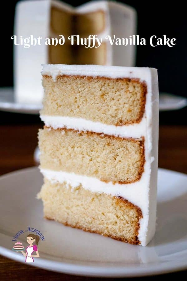 A slice of vanilla layer cake with buttercream frosting.