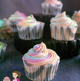 A cupcake with a colorful frosting.
