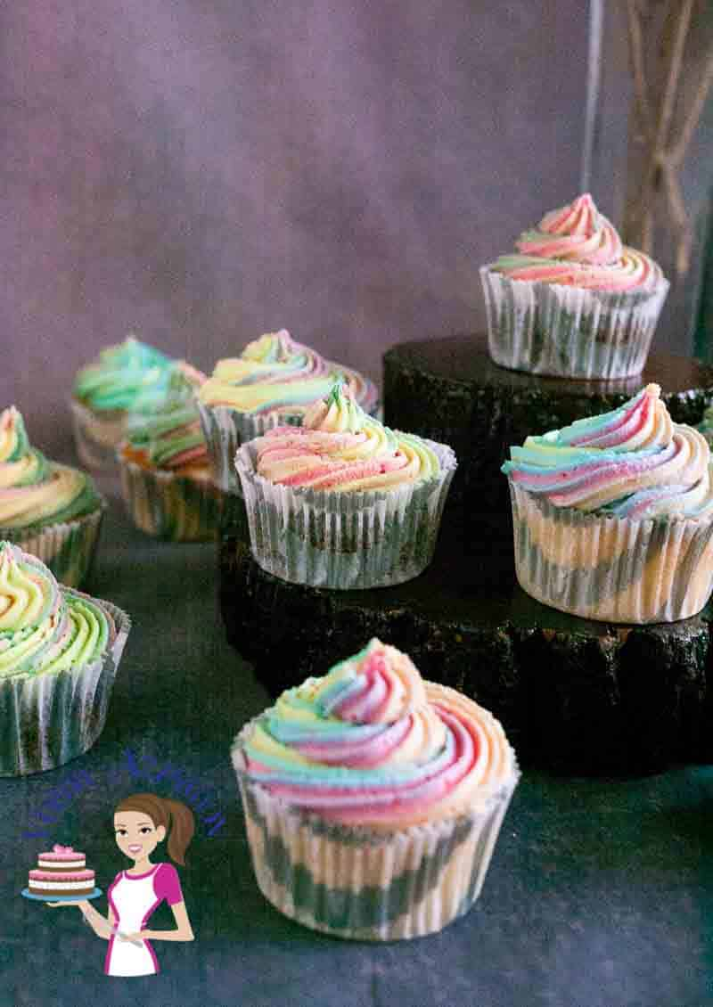 Cupcakes decorated with colorful frosting.