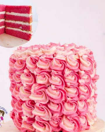 A strawberry cake with pink frosting.