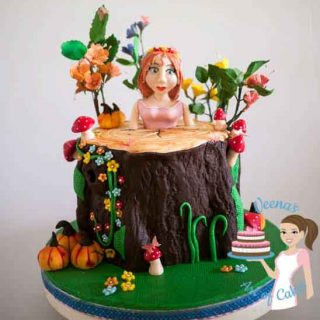 A cake decorated in an enchanted forest princess theme.