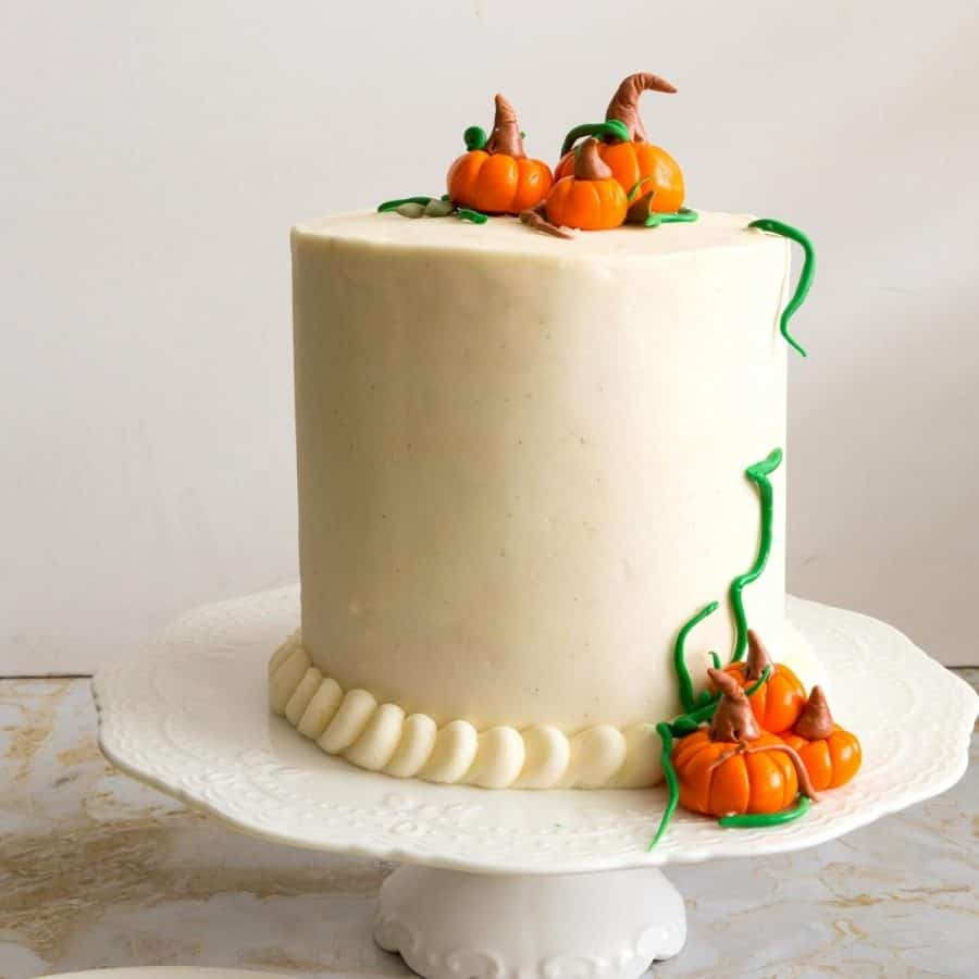 Pumpkin cake on cake stand frosted with this cream cheese frosting