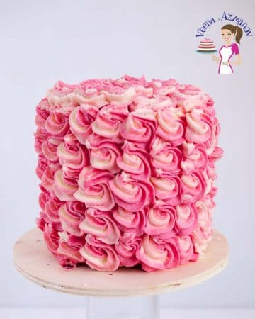 A strawberry cake with buttercream frosting.
