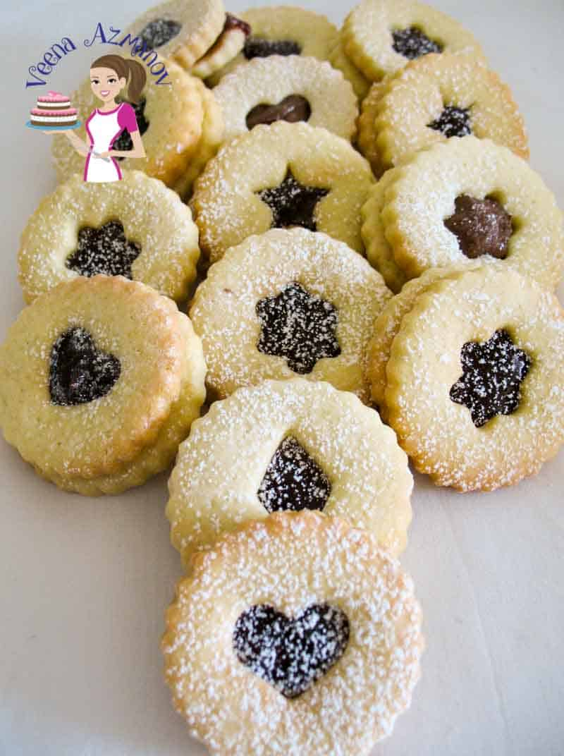What can be more festive than handing out cookies. These Almond Linzer Cookies are rich, crisp and buttery filled with jam, chocolate, Nutella or dulce de leche.