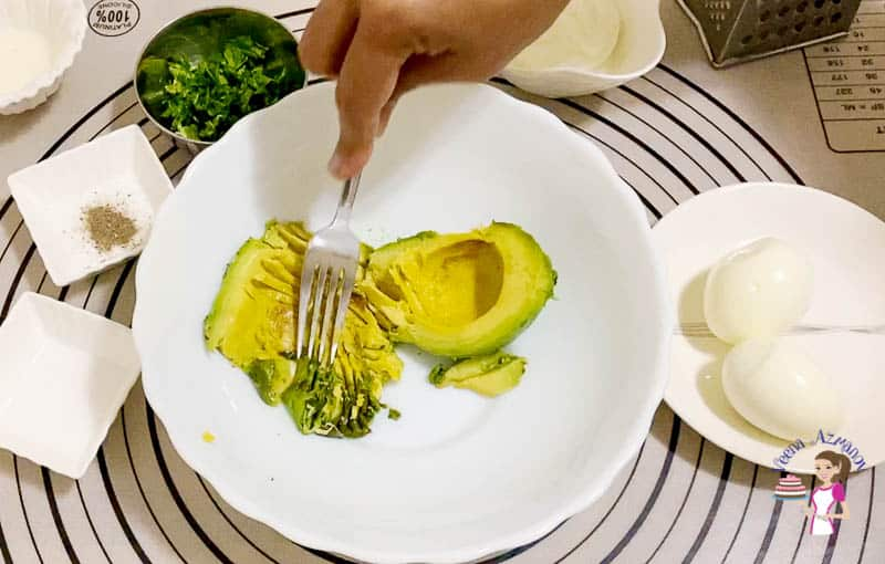 Mash the avocado with a fork for the sandwich spread