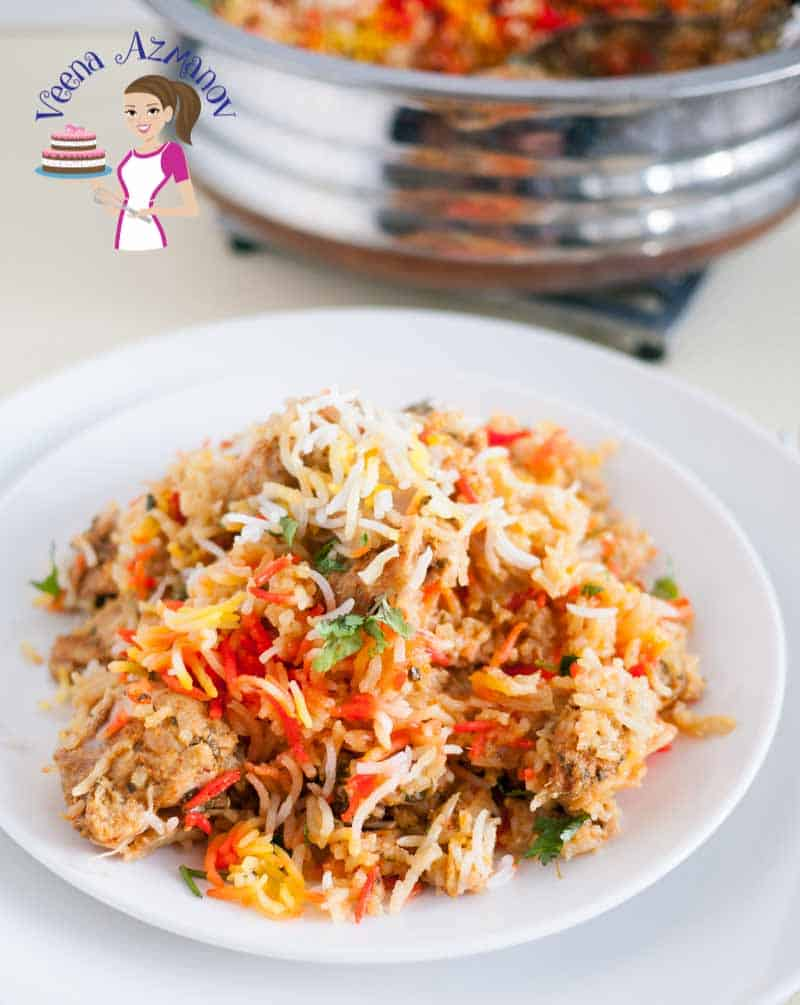 A plate served with this easy chicken biryani showing the colorful rice and the boneless chicken pieces.