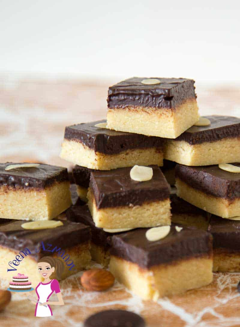 These chocolate marzipan squares are a real treat especially during the holiday season. They are little bites of heaven that just melt in the mouth made with almonds sugar and topped with chocolate. This simple easy and effortless recipe works great for those last minute food gift ideas.