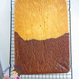 A Pinterest optimized image for half chocolate half vanilla sheet cake recipe using yellow cake batter for vanilla