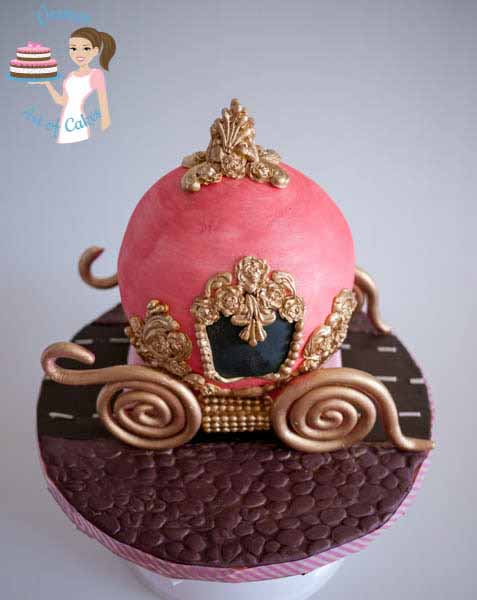 A cake decorated to look like Cinderella\'s carriage.