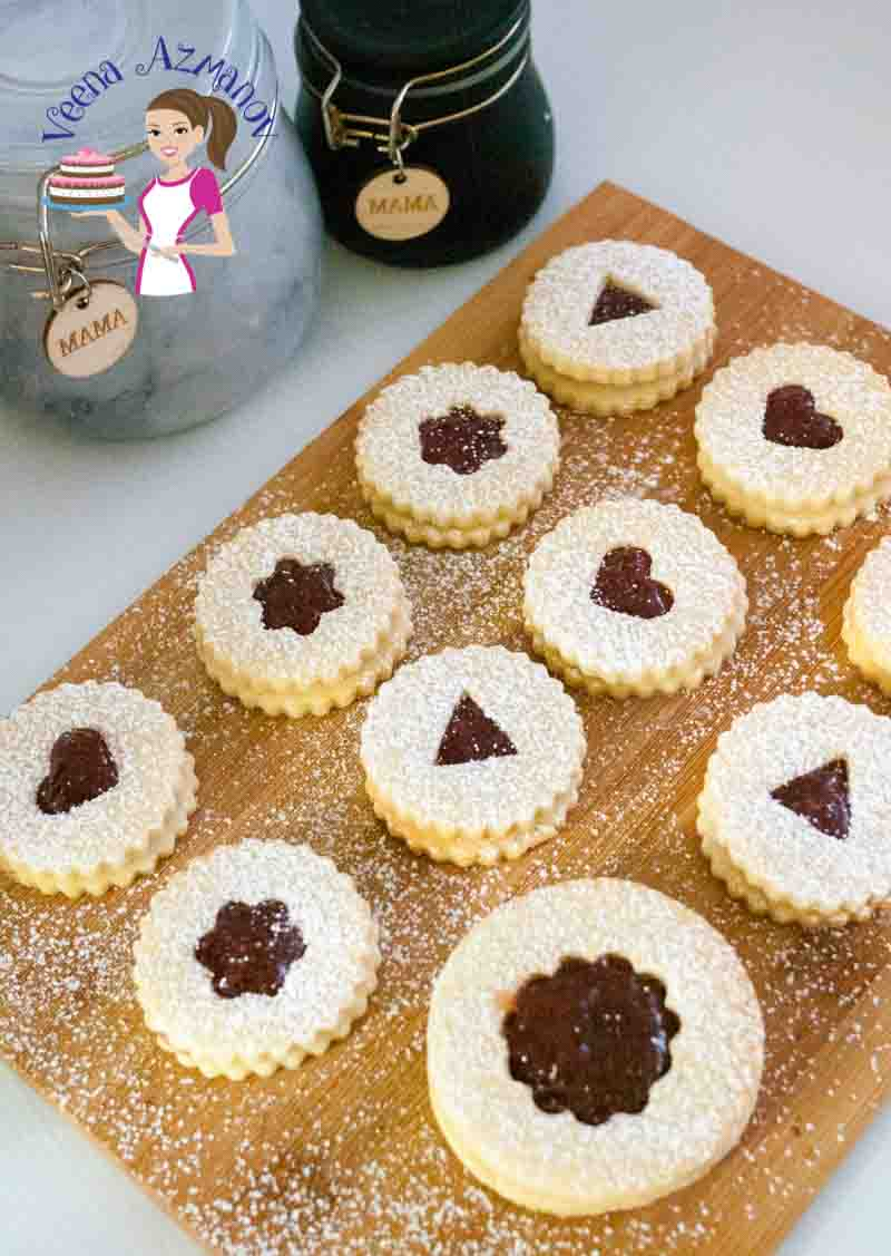 Linzer cookies aren't just for festive but the whole year round. Who doesn't love crisp thin short bread cookies sandwiched with delicious jam centers? They make impressive cookie jar gift ideas too.