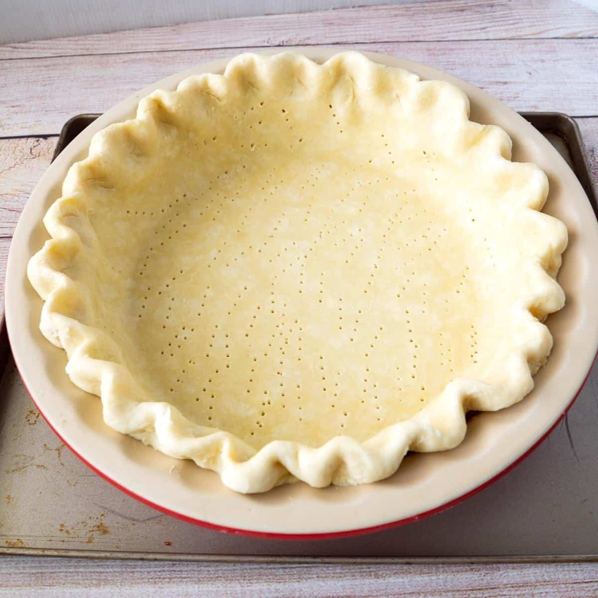 A pie pan lined with crust made from scratch.