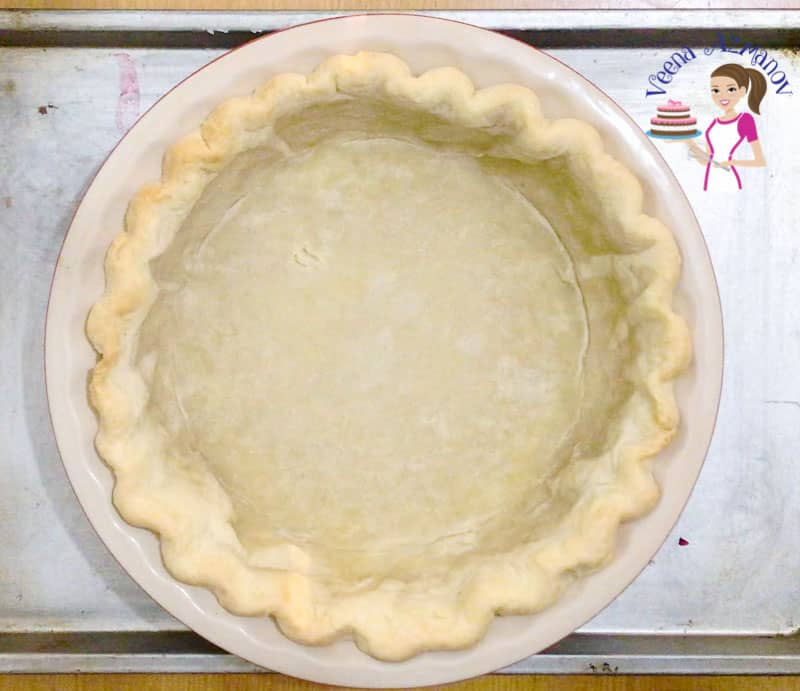 Remove the baking beans for a prebaked pie crust