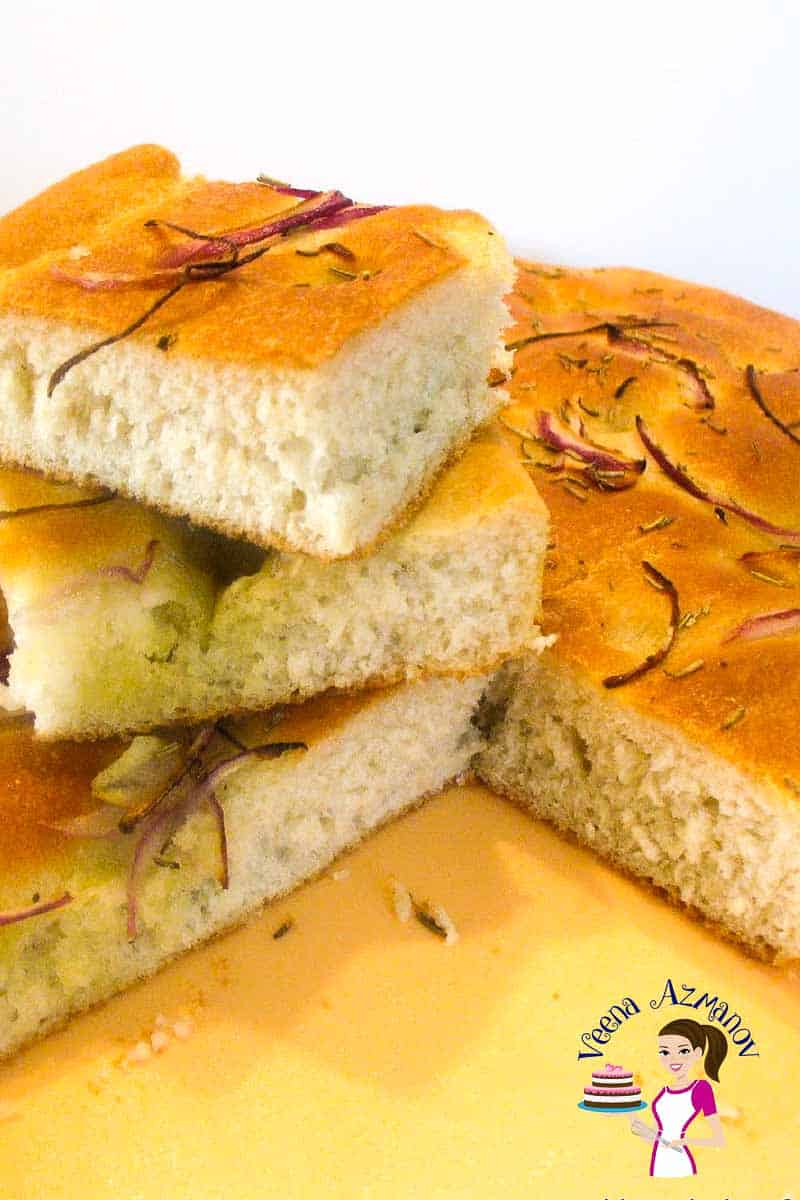 The cut bread - This Italian classic of homemade focaccia recipe is an absolute treat with any meal or just on it's own. Baked with some fragrant rosemary, sweet red onions and pungent garlic. Soft light bread on the inside with a golden delicious olive oil infused crust on the outside.