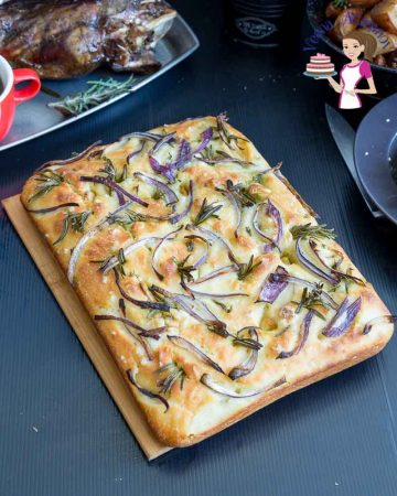An Italian focaccia bread with onions and rosemary.